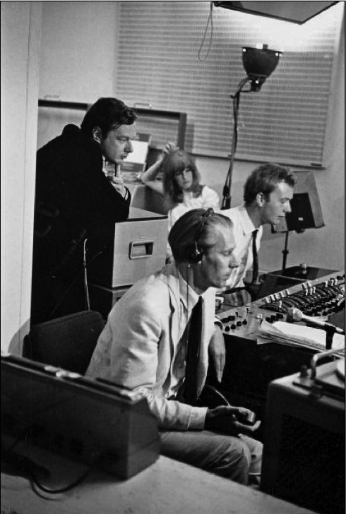 This image has an empty alt attribute; its file name is 1967_06_25-The-EMI-Studio-1-control-room-before-the-Our-World-broadcast-David-Magnus-photo.jpg